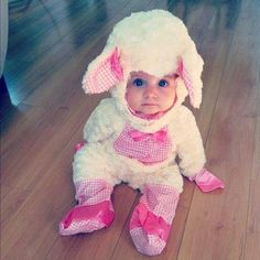 Cute baby dressed as a bunny with pink bows