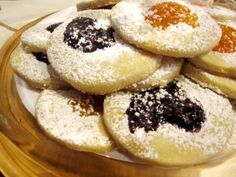 A Recipe for Kolacky Cookies  1 cup butter ½ cup powdered sugar (plus extra for sprinkling) 1 ½ tsp. vanilla 2 cups flour (more or less until firm) Jam or preserves (we use apricot and razzleberry) Mix ingredients. Roll out on a smooth surface; then cut out into circles. Thumbprint each circle and fill with a bit of jam. Bake on ungreased baking sheet at 350 for 10-15 minutes. Allow to cool; then sprinkle with powdered sugar. Serve with hot tea with milk and enjoy!
