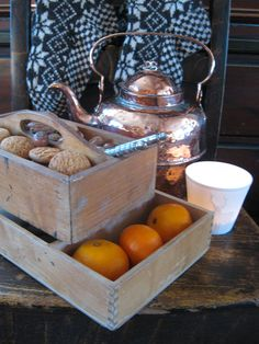Nuts and Clementines and som old style knitted socks. And I love the copper coffe kettle.