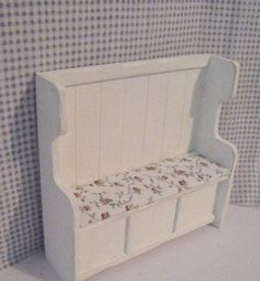 An Apple Cottage small settle or bench with lifting seat. Hand painted in white and lightly distressed to show age. An apple print seat,