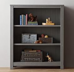 Paint bookcases one or two shades darker gray than the room