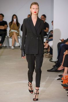 And those tuxedo suits. Theyskens' rival the very best of them. For spring, he did them with a tapered pants and a loose double breast with a hint of leather sleeves peeking out from below the sleeve.