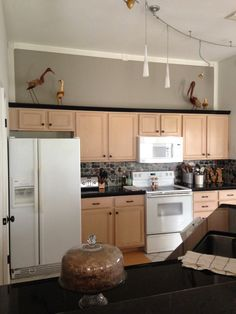 Making unsightly pickled oak cabinets look quite a bit less pink by just changing up the wall color.
