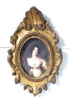 Antique painting in a gilded frame.