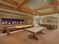 Gorgeous game room design with wooden frame ceiling