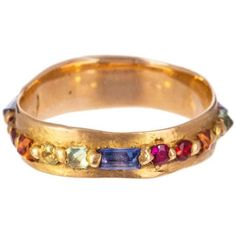 Polly Wales Wide Pinched Rainbow Sapphire Eternity Ring ($250) ❤ liked on Polyvore featuring jewelry, rings, rainbow jewelry, sapphire jewelry, rainbow sapphire jewelry, sapphire jewellery and sapphire eternity band ring