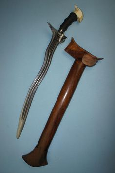 Buyers and sellers of antique swords, weapons and related artifacts. Fine and rare authentic antique swords, daggers & edged weapons from all corners of the world. Philippine Art, Javanese, Swords And Daggers, Arm Armor, Damascus, Blade, Sculptures, Jewelry Making, Bronze
