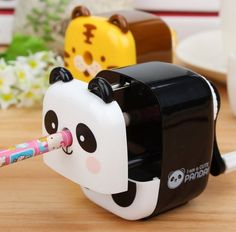 A helpful panda who sharpens pencils with his nose.