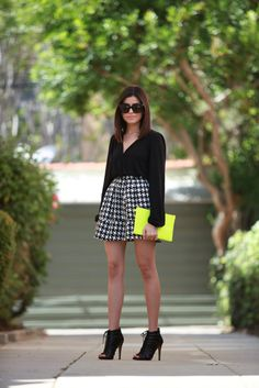 Via Just The Design: Sazan Barzani is wearing a mini skirt from Target with a black Lovers And Friends shirt and ankle boots from the Kardashian Kollection