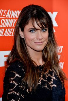 A smooth blowout isn't complete without slightly curled bangs à la Amanda Peet.