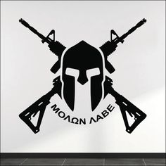 """This premium quality removable vinyl wall decal features original vector art of two crossed AR-15s with a Spartan helmet at the center along with the Greek phrase """"Molon Labe"""". Available sizes: - 24"""""""