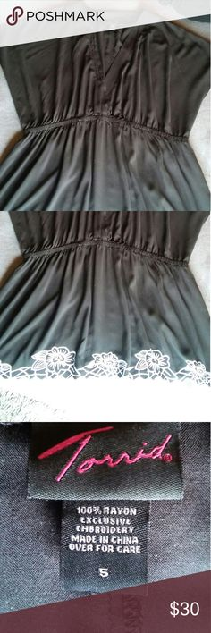 Black Torrid embroidered top size 5 Black tunic with white embroidered flowers all the way around the hem,beautiful & flowy. Deep v neck,never used nwot. I have one in yellow too, size 5, just haven't taken pics yet,will post later. So pretty! torrid Tops