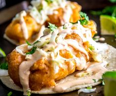 It's tough to beat fried fish drenched in a Chipotle Crema sauce. These Baja Fish Tacos are also served up with a batch of pickled cabbage -- too good! Fish Tacos With Cabbage, Cod Fish Tacos, Fried Fish Tacos, Baja Fish Tacos Sauce, Mexican Fish Tacos, Baja Shrimp Tacos, Mahi Mahi Fish Tacos, Tilapia Tacos, Fish Recipes