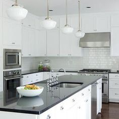 Beth Haley Design - kitchens - microwave nook, kitchen island dishwasher, dishwasher kitchen island, island dishwasher, kitchen hood, kitchen hood cabinets, glossy white subway tiles, glossy white subway tile backsplash, glossy subway kitchen tiles, corbels, kitchen island corbels, white kitchen island corbels, schoolhouse pendants, kitchen schoolhouse pendants, kitchen island schoolhouse pendants, island schoolhouse pendants, floor to ceiling kitchen cabinets, absolute black granite…