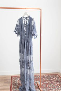 Gorgeous embroidered lace maxi dress Plunging V neckline Scalloped trim Side slits Zipper back Non-stretch lace Lined neckline and shorts underneath Available