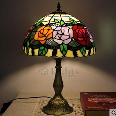 The Tiffany table lamp is made of zinc alloy base in bronze color and stained glass shade.Using screw base. Rose pattern decorates the glass shade add a sense of romantic for bedroom, also can be used for living room or study room. Stained Glass Lamp Shades, Stained Glass Panels, Leaded Glass, Home Office, Tv Wand, Small Lamp Shades, House Lamp, Turkish Lamps, Room Lamp