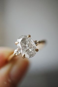 Highlighting a one-of-a-kind, conflict-free Oval Salt and Pepper diamond. Engagement Rings Canada, Designer Engagement Rings, Diamond Engagement Rings, Dainty Bracelets, Dainty Jewelry, Fine Wedding Jewelry, Wedding Rings, Salt And Pepper Diamond, Opal Rings