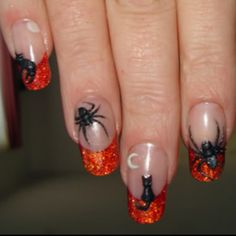 Halloween nail art.  Not crazy about the spiders but love the cats.