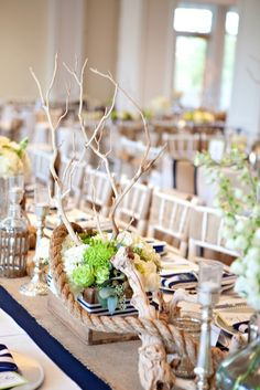 Nautical-inspired centerpieces // Maria Glassford Photography // http://www.theknot.com/submit-your-wedding/photo/b0a94f48-7131-466c-be88-367e2d989acf/kyndra-kyle