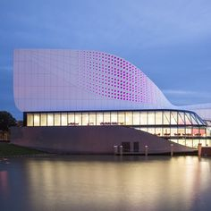 UNStudio has completed a theatre in the Dutch town of Spijkenisse, featuring a spotty facade that glows purple and an auditorium with a ceiling that moves.