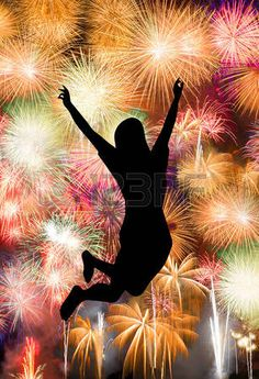 Silhouette of girl jumping happy enjoy brightly colorful fireworks in the night sky photo