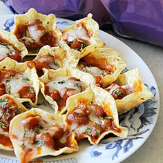 Great and simple appetizer dish: mini nacho bowls! Great for potlucks, BBQs, sports gatherings, an appetizer, or a snack!