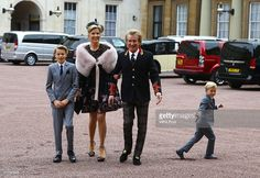 Sir Rod Stewart with his wife, Penny Lancaster and children Alastair (age 10) and Aiden (age 5) after he received his knighthood in recognition of his services to music and charity at Buckingham Palace on October 11, 2016 in London, England.
