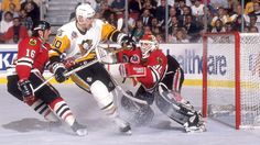 PITTSBURGH, PA - MAY, 1992: Ron Francis #10 of the Pittsburgh Penguins crashes into goalie Ed Belfour #30 of the Chicago Blackhawks as Michel Goulet #16 of the Blackhawks follows behind during the 1992 Stanley Cup Finals in May, 1992 at the Pittsburgh Civic Center in Pittsburgh, Pennsylvania. (Photo by B Bennett/Bruce Bennett Studios/Getty Images)
