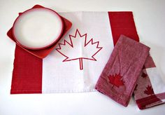 Lovely red and white maple leaf adorned linens and dishes for Canada Day. #party #table #napkins #Canada #Canada_Day #Canadian #red #white