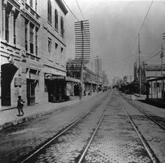 San Antonio 1890 - E. Houston St. looking east from bridge over the SA river. Photo shows utility poles beside the mesquite block street. Streetcar tracks in center. At left center is the 3 story Alamo Iron Works building (Northwest corner of E. Houston St. and N. St. Mary's St.) Campbell and Co. on right.