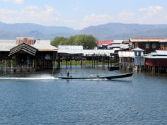 A long-tail boat cruises past the stilt houses of Nanpan village at the south end of Inle Lake, Myanmar (Burma). House On Stilts, Inle Lake, Cruises, Past, Past Tense, Cruise