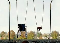 """""""Public art installation in front of a rehabilitation center for handicapped children. Both children with and without disabilities can choose which of the two swings they want to use. An early reminder of the parallel realities in life."""""""