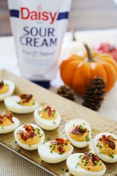 Bacon, Chive + Sour Cream Deviled Eggs - Creamy, crispy and full of flavor! All you need is 20 minutes and a handful of ingredients for the perfect party bite! thecomfortofcooking.com #ad