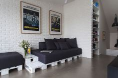 sofa with integrated side table made of pallets
