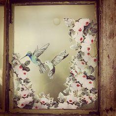 Framed paper birds.