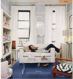 Domino Magazine - Ideas for small spaces: White curtains + faux paneling + modern fabric + tidy storage