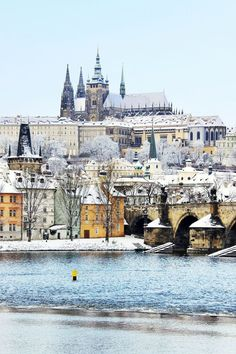 Snowy Prague gothic Castle with the Charles Bridge, Czech Republic  Snow makes everything look better!
