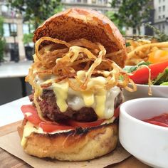 Open wide!  You'll need to for @thepavilionnyc's massive All-natural Beef #Burger with crispy onions organic tomato melted gruyere and saffron aioli. A delicious and hearty #cheeseburger to enjoy while dining #alfresco in their lovely patio overlooking @unionsquareny. #thepavilion #unionsquare #unionsquarepark #patiodining #nycburger  #nyceats #eeeeeats @hotbunsclub #hotbunsclub by jeaniusnyc