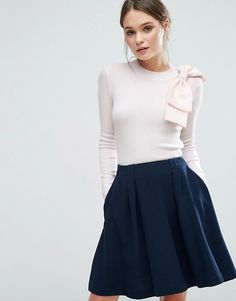 pink long sleeve knit top with bow