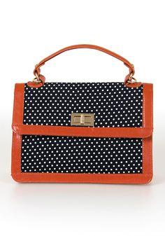A Bit Dotty Satchel: Orange & Navy satchel from SpottedMoth.com.  My current favorite color combo!