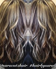 Dramatic blonde and brown hair highlights lowlights curls texture soft blonde brunette