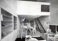 The living room of a typical dwelling unit; the interior staircase leads to the bedrooms. - le Corbusier