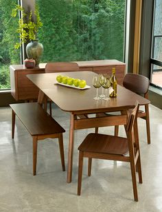 """Crafted in 100% solid bamboo, the Currant dining table extends from 72"""" to 92"""" to seat all of your guests comfortably. Shown in dark walnut finish."""