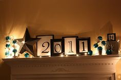 Almost finished making this happen! And didn't have to buy a thing :) So excited!! New Years Mantel