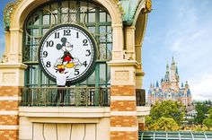 """ALMOST TIME - A Shanghai Disneyland cast member prepares the theme park's iconic """"Mickey Avenue"""" clock in advance of the Grand Opening of Shanghai Disney Resort on June 16, 2016 with the spectacular backdrop of the world's largest Disney castle, The Enchanted Storybook Castle. Shanghai Disney Resort is a world-class family entertainment destination, imagined and created especially for the people of China. Ideal for multiple-day visits, the resort consists of Shanghai Disneyland, a theme…"""