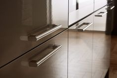 Chrome Bar Handles And Gloss Cabinets Are Perfect For Creating A Modern Look In Your Kitchen