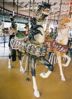 Carmel 2nd Row Stander - The 1915 Mangels/Carmel Carousel at Rye Playland, Rye, NY. Constructed in 1915, this is a great work of mechanical precision and artistic merit.  Sixty-six horses with jewel-studded harnesses and three elaborate chariots circle the rare Gavioli band organ. © John Caruso