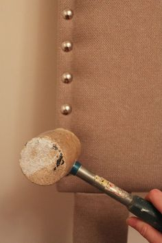 A step by step tutorial for a DIY padded headboard created using plywood, upholstery foam, and fabric.