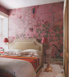 Perfect orange and pink room.  With the white nail head trim headboard sending it over the top.