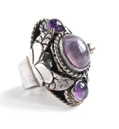Vintage Sterling Silver Poison Ring -  Taxco Genuine Amethyst Stone Mexico Ring / Purple Art Nouveau. $55.00, via Etsy.